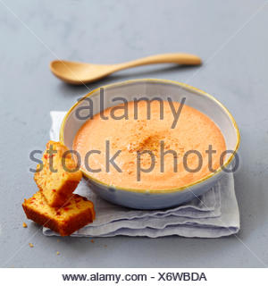 Cream of red pepper soup with sweet corn bread - Stock Photo