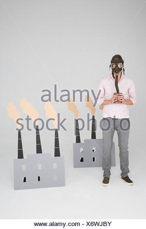 A man wearing a gas mask - Stock Photo