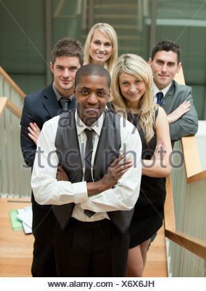 Confident business team looking at the camera - Stock Photo