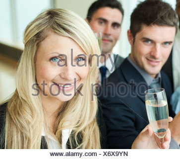 Businesspeople celebrating a success with champagne - Stock Photo