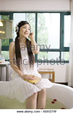 Young woman wearing the headphone and enjoying herself - Stock Photo