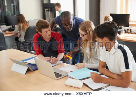Design Students With Teacher Working In CAD/3D Printing Lab - Stock Photo