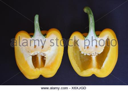 Close-Up Of Halved Yellow Pepper With Anthropomorphic Face