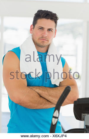 Serious young man working out at spinning class - Stock Photo