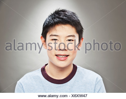 Portrait of young Asian teenage boy - Stock Photo