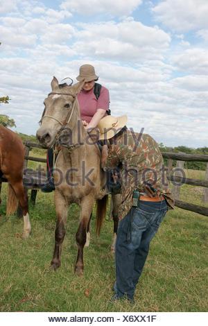 People, Horse, Pantanal, Mato Grosso do Sul, Brazil - Stock Photo