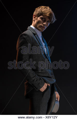 Redheaded man in a plaid suit with hat - Stock Photo