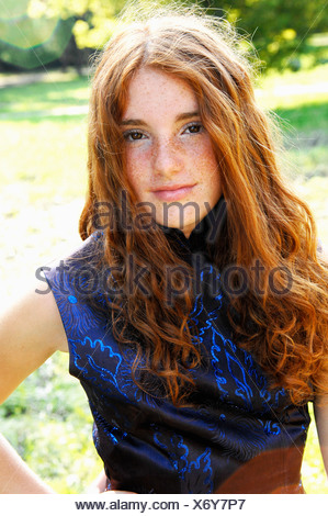 Girl wearing evening gown - Stock Photo