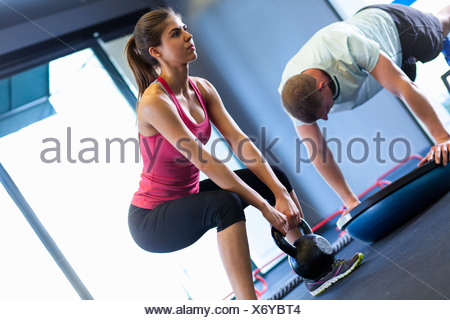 Couple working out in gym - Stock Photo