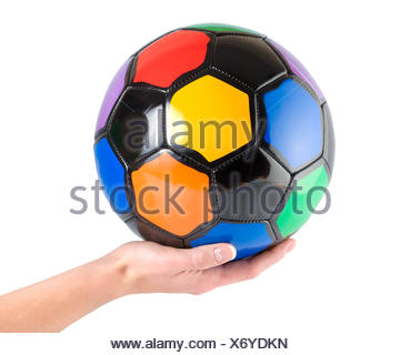 Soccer ball in hand isolated on white background. - Stock Photo