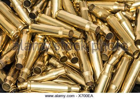 Pile of empty bullet shells - Stock Photo