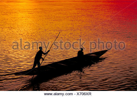 fishing boot at sunset, Mali - Stock Photo