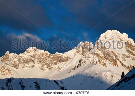 Mountains covered with snow near Fuciade hut at sunset, San Pellegrino pass, Trentino Alto Adige, Italy, Europe - Stock Photo