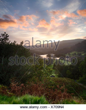 Sunrise over Rydal Water in Lake District - Stock Photo