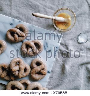 Homemade salted pretzels with egg wash - Stock Photo