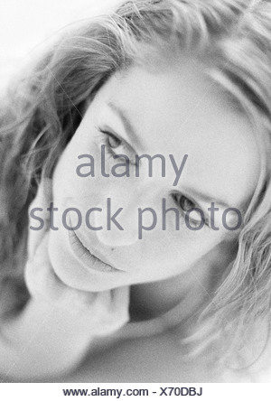 Woman's face, hand under chin, close-up, black and white portrait - Stock Photo