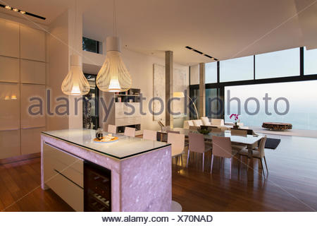 Modern kitchen and living area overlooking ocean - Stock Photo
