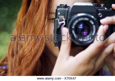 Close-Up Of A Female Photographer - Stock Photo