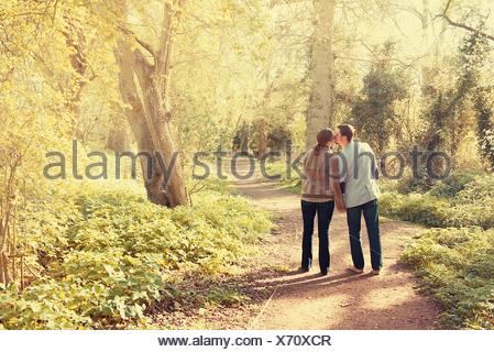 Couple walking in the park - Stock Photo
