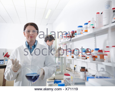 Scientists conducting test in laboratory - Stock Photo