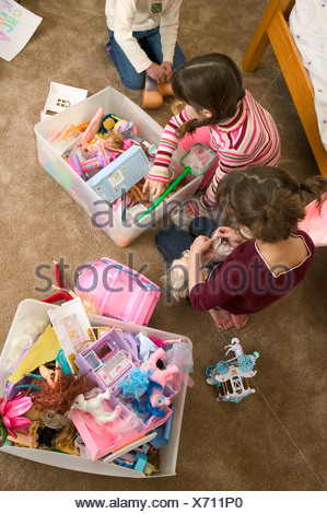 Young girls playing with dolls - Stock Photo