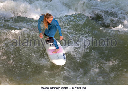 Surfer on the Eisbach in the English garden, Munich, Upper Bavaria, Bavaria, Germany, - Stock Photo