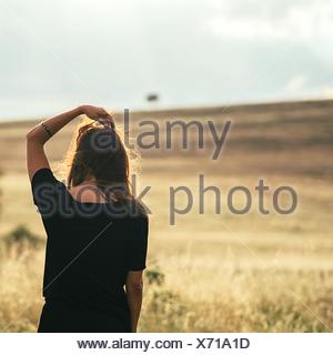 Woman Overlooking Countryside Landscape - Stock Photo