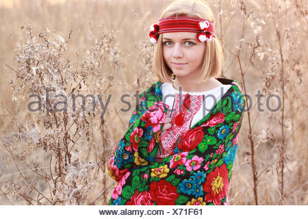 Portrait of young woman wearing traditional shawl - Stock Photo