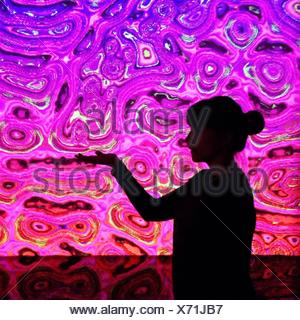 Woman With Biological Pattern Backdrop