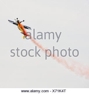 Low angle view of performing stunt plane - Stock Photo