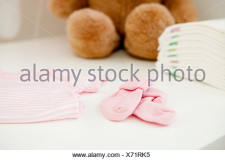 Baby clothes and bear - Stock Photo