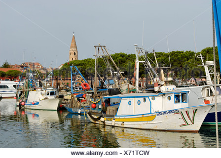 Caorle at the Adria region Veneto Italy at the fishing harbour with the church - Stock Photo