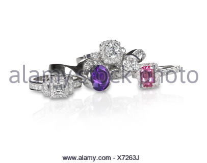 Cluster stack of diamond wedding engagment rings - Stock Photo