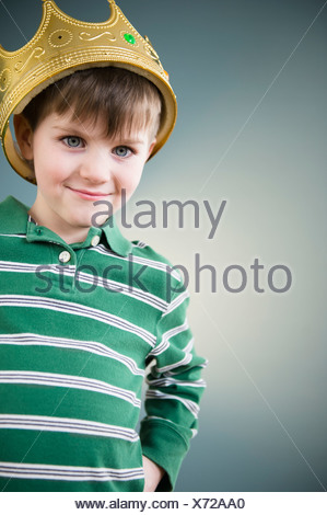 Portrait of boy (4-5) wearing crown - Stock Photo