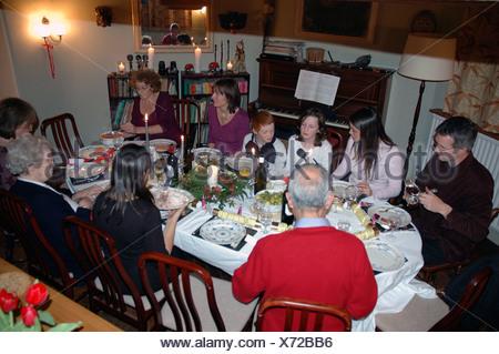 Extended family eating Christmas Day dinner UK - Stock Photo