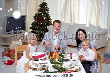 Family celebrating christmas dinner with turkey - Stock Photo