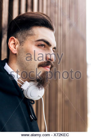 Portrait of stylish young man with headphones - Stock Photo