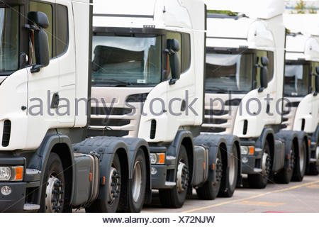 Freight transportation trucks parked in a row - Stock Photo