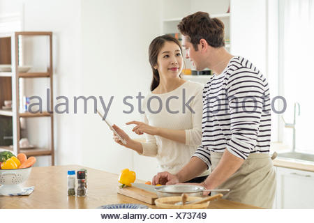 Harmonious multicultural family couple - Stock Photo