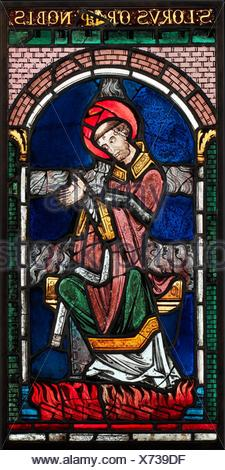 Martyrdom of Saint Lawrence. Date: ca. 1180; Geography: Made in Canterbury, Kent; Culture: British; Medium: Pot-metal glass, vitreous paint; - Stock Photo
