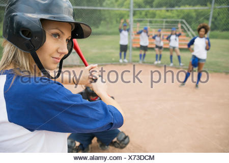 Baseball player ready for ball at home plate - Stock Photo