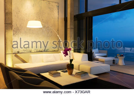 Lamp and sofa in modern living room - Stock Photo