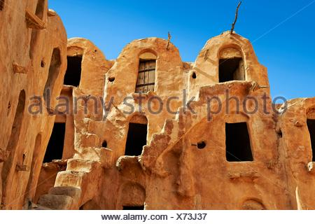 Ksar Ouled Soltane, a traditional Berber and Arab fortified adobe vaulted granary cellars, or ghorfas, situated on the edge of the northern Sahara in - Stock Photo