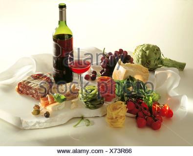 Still: Italien food: Artichokes, parmesan, tomatoes, basil, pasta, ciabatta, olives, parma ham, mozzarellá - Stock Photo