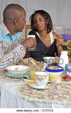 Kenyan couple sharing breakfast, Nairobi, Kenya - Stock Photo