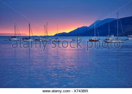 Sailing boats in harbour at sunset, Ushuaia, Tierra del Fuego, Argentina - Stock Photo