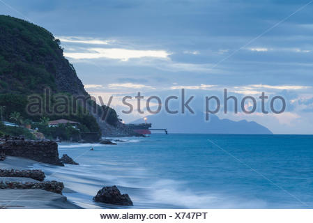Netherlands, Sint Eustatius, Oranjestad, Oranjestad Bay, elevated view of oil tanker and Saba Island, dusk - Stock Photo