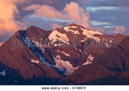 Alpenglow on Calliope Peak at sunset, Chugach Mountains, Chugach State Park, Southcentral Alaska, Summer - Stock Photo