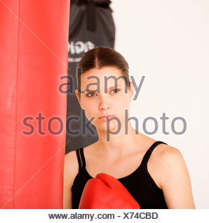 A young woman boxing - Stock Photo