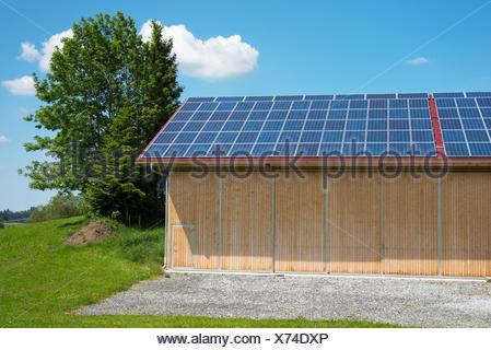 solar power panels on roof of new barn - Stock Photo